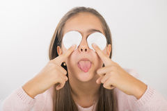 Skin cleansing. Teen girl holds cotton pad near the face. teen cleansing, beautiful girl holding a cotton ball near the face royalty free stock photo