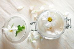 Skin cream and beauty flower Stock Images