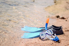 Skin diving equipment standing ready on a beach Stock Photos