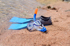 Skin diving equipment standing ready on a beach Stock Image