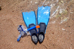 Skin diving equipment standing ready on a beach Stock Images