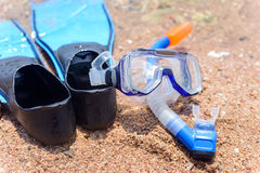 Skin diving gear at the edge of the ocean Stock Photos