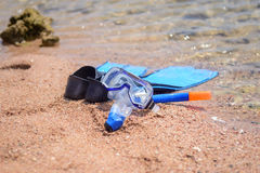 Skin diving gear at the edge of the ocean Royalty Free Stock Image