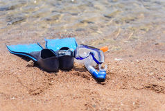 Skin diving gear at the edge of the ocean Stock Images