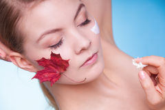 Skin. Face of young woman girl with leaf cream Stock Photos