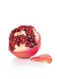 Skin-off pomegranate on isolated background Stock Photography