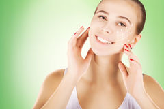Skin renovating, portrait with empty space over green background Stock Photos
