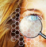 Skin survey. Face of a woman with abstract honeycomb pattern and magnifier Stock Photos