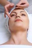 Skin treatment applying. Applying of vitamin capsule treatment for facial skin in the beauty salon Stock Photo