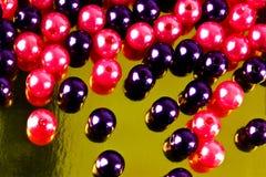 Skina pryder med pärlor Arkivbild