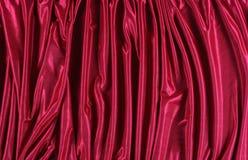 Skina röd satäng Arkivfoton