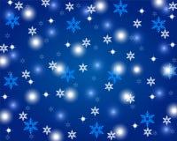 Skinande blå bakgrund för jul Arkivbilder