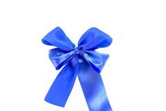 Skinande blått satängband på vit bakgrund Royaltyfria Bilder