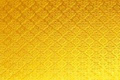 Skinande för målat glasstextur för gul guld bakgrund royaltyfri fotografi