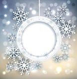 Skinande feriebakgrund för vektor med snöflingor och ramen Arkivfoto
