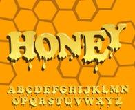 Skinande glasat, honungalfabetdesign Smältande stilsort Arkivfoton