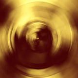 Skinande gul texturbakgrund för guld- folie Arkivbild