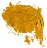 Skinande guld- borsteslaglängd av acrilic eller oljamålarfärg a royaltyfri illustrationer