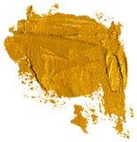 Skinande guld- borsteslaglängd av acrilic eller oljamålarfärg arkivbilder