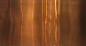 Skinande guld- folie, brons eller koppartextur för metallmodellyttersida Närbild av inre material för designgarneringbakgrund arkivbilder