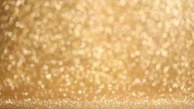 Skinande guld- ljusbakgrund stock video