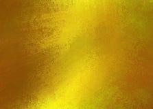 Skinande guld texturerad bakgrund Royaltyfria Bilder