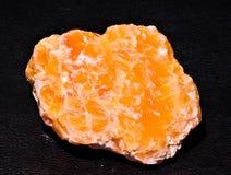 Skinande halitesten för orange guling arkivbild