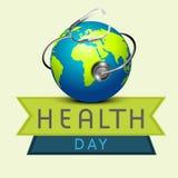 Skinande jordklot med stetoskopet för dag för världshälsa Arkivfoto