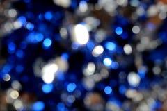 Skinande jul för lynne för färg för bakgrundsvitblått royaltyfria bilder