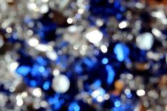 Skinande jul för lynne för färg för bakgrundsvitblått arkivbild