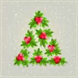 Skinande julgran som komponeras från gröna sidor Arkivfoton