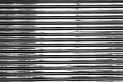 Skinande metallvägg Arkivbilder
