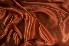 Skinande rött satängtyg Royaltyfria Bilder