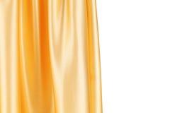 Skinande siden- orange gardin Arkivfoton