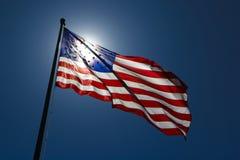 skinande sun för amerikanska flaggan Royaltyfri Bild
