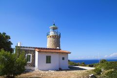 Skinari Lighthouse in summer season. Zakynthos island, Greece. Lighthouse of Keri located at the Marathias cape on Zakynthos island in Greece stock images