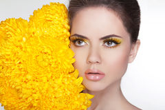 Skincare. Attractive young woman with flowers. Cleansing and moi Royalty Free Stock Images