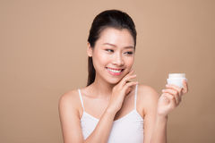 Skincare. Beautiful asian woman show moisturizer or lotion produ Stock Photography