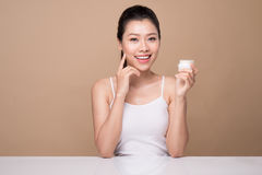 Skincare. Beautiful asian woman show moisturizer or lotion produ Royalty Free Stock Photos