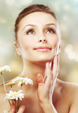 Skincare. Beauty with herbs. Skincare. Beautiful Spring Girl with Chamomile flowers. Healthy skin. Herbal cosmetic concept Royalty Free Stock Photo