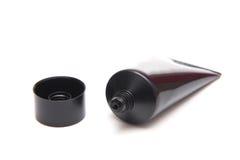 Skincare in black plastic tube isolated on white background Stock Images