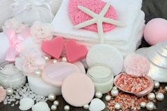 Skincare and Body Care Beauty Treatment. Including pink heart shaped soaps, himalayan exfoliating salt, sponges, face cloths, moisturising lotion, powder puffs Stock Photography