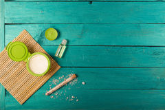 Skincare essentials on a wooden background Royalty Free Stock Photo