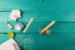 Skincare essentials on a wooden background Royalty Free Stock Image