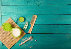 Skincare essentials on a wooden background Royalty Free Stock Photos
