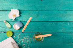 Skincare essentials on a wooden background Royalty Free Stock Photography