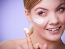 Skincare. Face of young woman girl taking care of dry skin. Skincare habits. Face of young woman with leaf as symbol of red capillary skin on violet. Girl Royalty Free Stock Photography