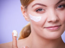 Skincare. Face of young woman girl taking care of dry skin. Skincare habits. Face of young woman with leaf as symbol of red capillary skin on violet. Girl Stock Photos