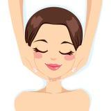 Skincare Facial Massage. Beautiful young woman enjoying facial massage skincare treatment Stock Photography