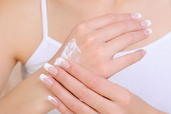 Skincare of hands by using  moisturizing cream Royalty Free Stock Photo